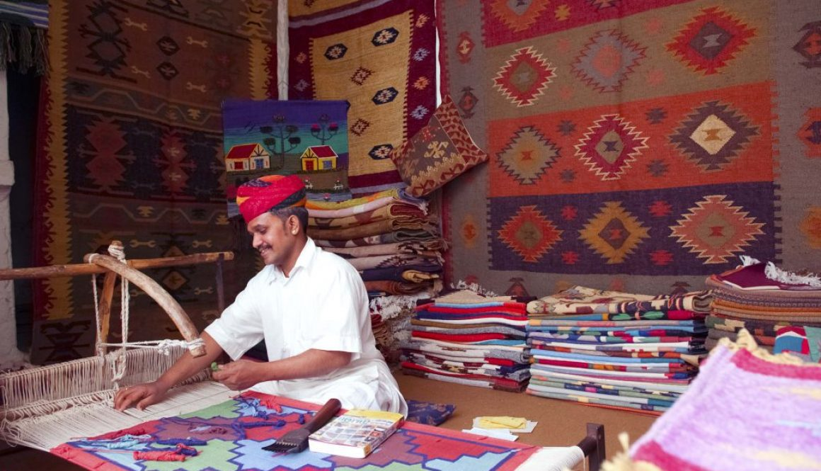 a person working on a Handlooms From India